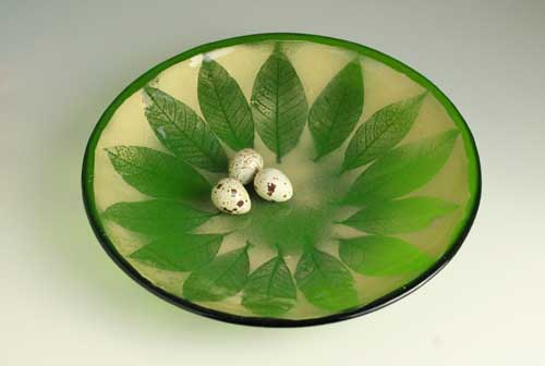 Fused glass bowl, leaf skeletons of gold mica over green