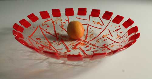 Fused glass bowl with reds (apricot, not glass)