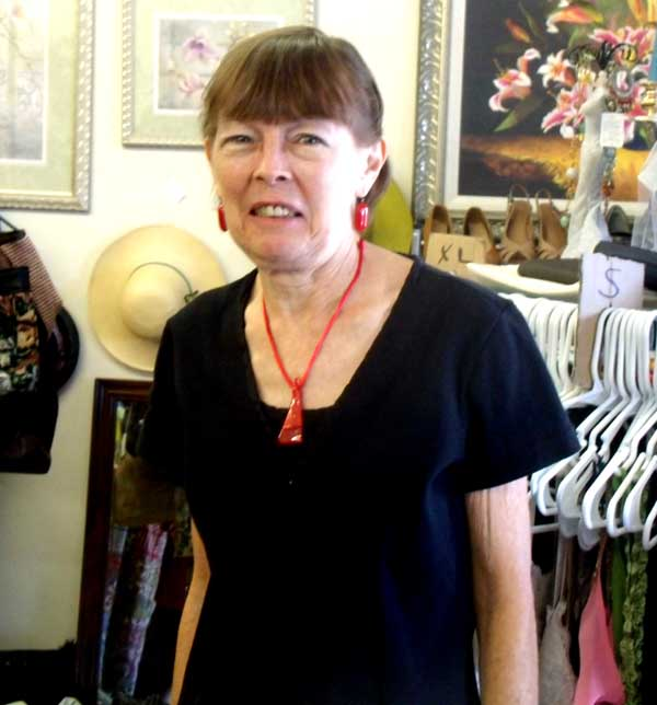 Ann, up close, in black top set off by a bright red fused glass pendant and matching earrings.