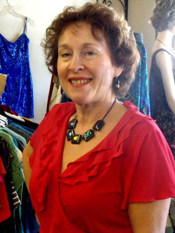 Jacqueline in red dress, up close, with fused glass necklace and matching earrings
