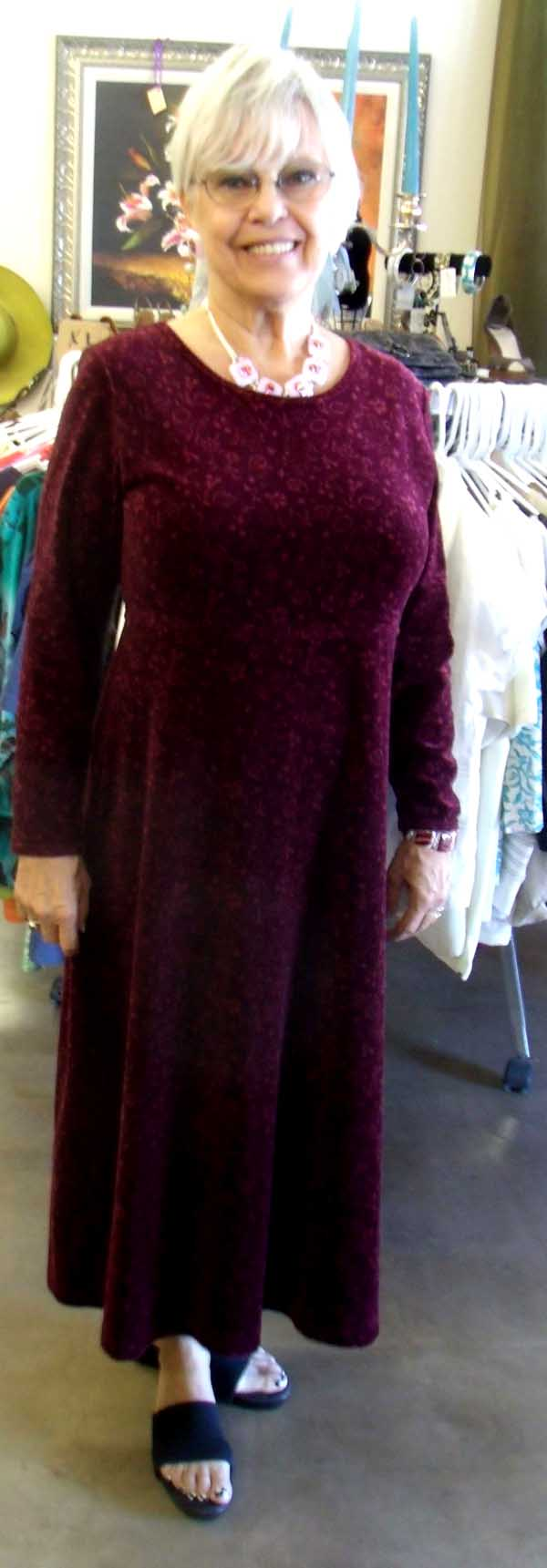 Joanne shows off a burgundy dress, highlighted by a five-piece fused glass necklace in pink, with magenta and red dichroic, and matching earrings