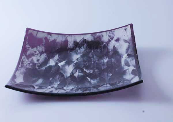 "Fused glass plate, plum glass with white ""mica"" leaf designs"
