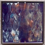 Layers of Leaves, fused glass with mica mounted over mirror, by Diane C. Taylor