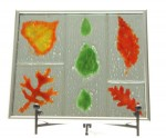 Leaves -- Spring and Fall, fused glass mounted over mirror, by Diane C. Taylor