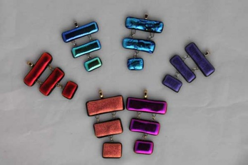 Group of dichroic pendants by Diane C. Taylor