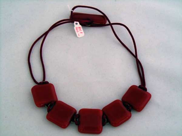 5-piece necklace, red glass with matching fob, on dark red rattail cord, $60.00